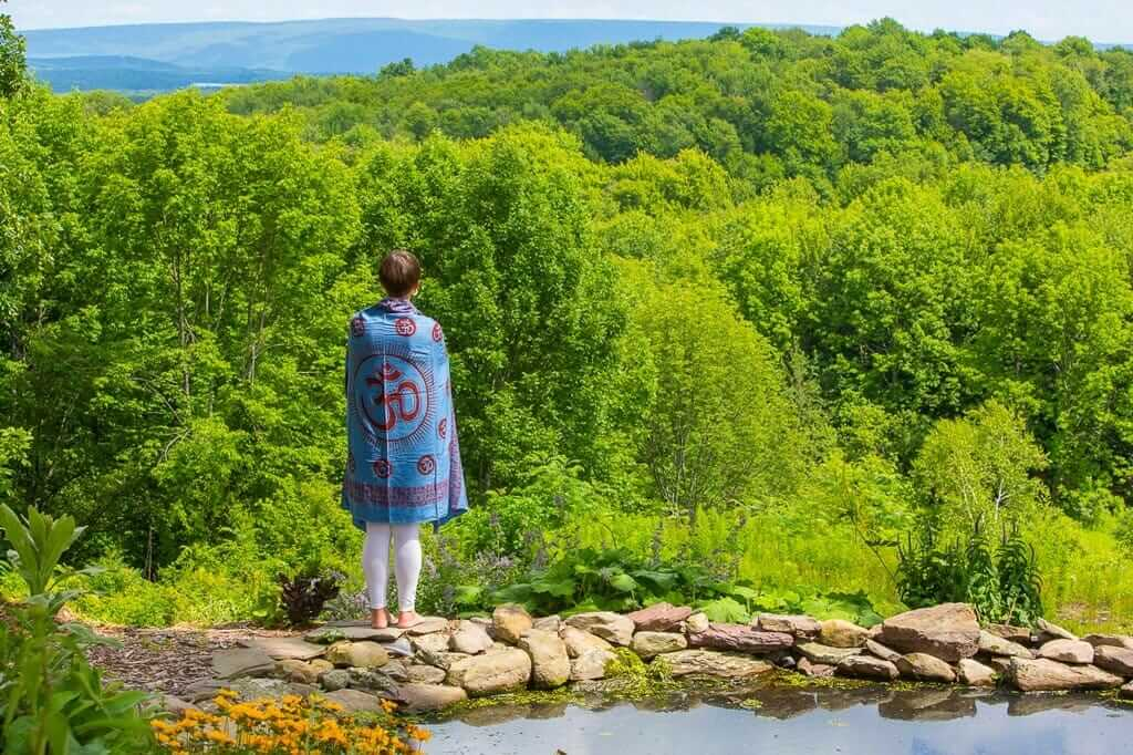 Woman overlooking Forest and Water